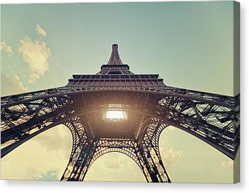 French Culture Canvas Print - Light Shining Through Eiffel Tower by Philipp Klinger