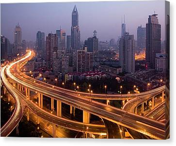 Light Trails On Highway Canvas Print by Leniners