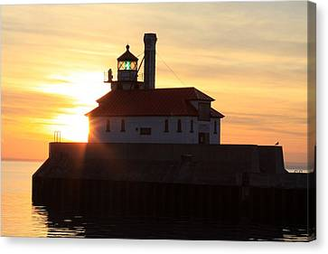 Lighthouse At Dawn Canvas Print by Rick Rauzi