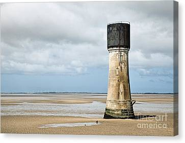 Lighthouse At Low Tide Canvas Print by Jon Boyes