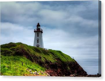 Lighthouse On A Cliff Canvas Print by Matt Dobson