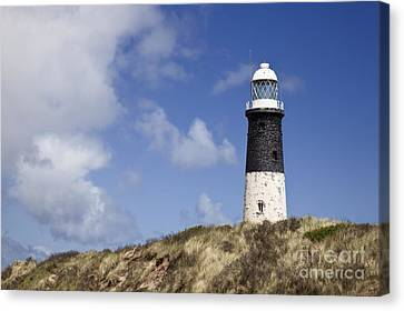 Lighthouse On Hillside Canvas Print by Jon Boyes