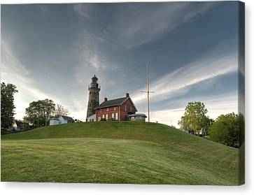 Lighthouse On The Hill Canvas Print by At Lands End Photography