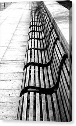 Line Of Empty Benches Canvas Print by Christoph Hetzmannseder