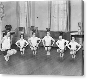 Line Of Girls (7-12) Exercising With Bowls On Heads (b&w) Canvas Print by Hulton Archive