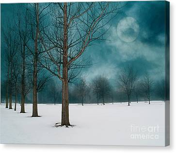 Line Of Trees Border A Snowy Field With A Rising Moon In A Cloudy Sky.  Canvas Print by Emilio Lovisa