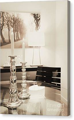 Lit Candles In Silver Candlesticks Canvas Print by Andersen Ross