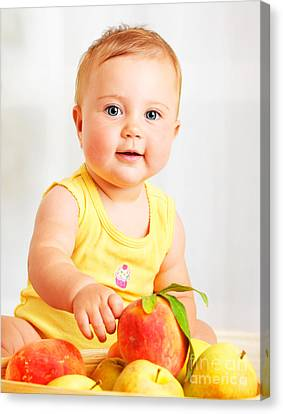 Little Baby Choosing Fruits Canvas Print by Anna Om