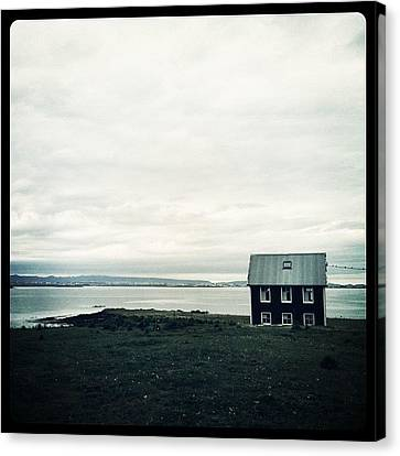 Little Black House By The Sea Canvas Print by Luke Kingma