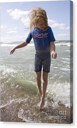 Little Girl Jumping In The Surf In Lake Michigan Canvas Print by Christopher Purcell
