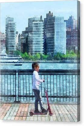Little Girl On Scooter By Manhattan Skyline Canvas Print by Susan Savad