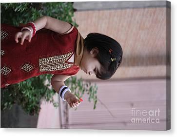 Little Girl With Flower Canvas Print by Muhammad Junaid Rashid