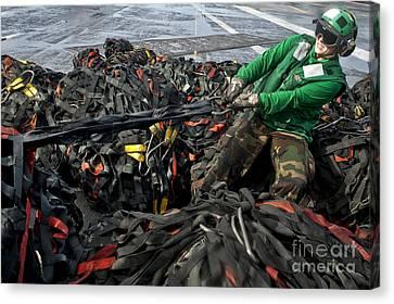 Logistics Specialist Wraps Cargo Nets Canvas Print by Stocktrek Images