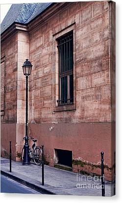 Canvas Print featuring the photograph Lone Bike by Kim Wilson
