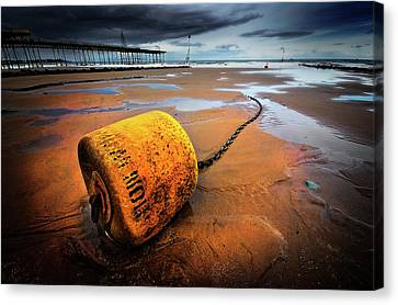 Lonely Yellow Buoy Canvas Print by Meirion Matthias
