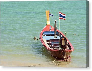 Longtail Boat At Sea Canvas Print by Bill Brennan