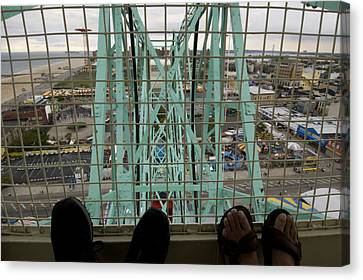 Looking Down At Two Peoples Feet Canvas Print by Todd Gipstein