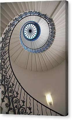 Looking Up At A Spiral Staircase Canvas Print by Axiom Photographic