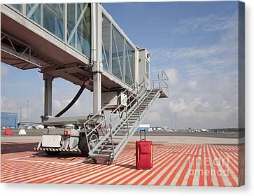 Luggage At A Gate Bridge Canvas Print by Jaak Nilson