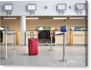 Luggage At An Airline Check-in Counter Canvas Print