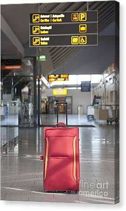 Luggage Sitting Alone In An Airport Terminal Canvas Print by Jaak Nilson