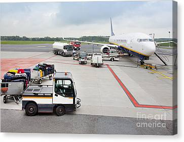 Luggage Transported To An Airprot Canvas Print by Jaak Nilson