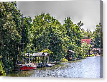 Magnolia River With A Red Sailboat Canvas Print