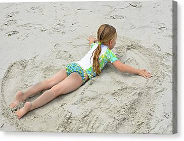 Canvas Print featuring the photograph Making A Sand Angel by Maureen E Ritter