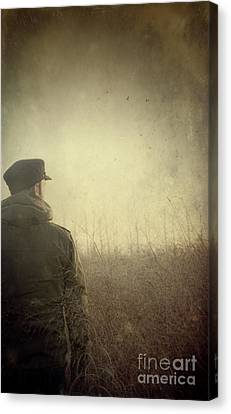 Man Alone In Autumn Field Canvas Print by Sandra Cunningham