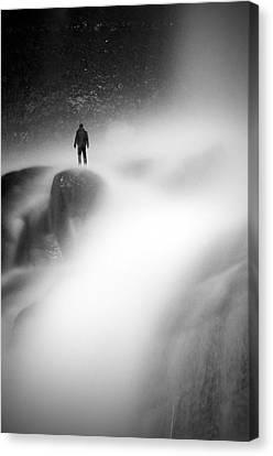 Man At Waterfall Canvas Print by Micael  Carlsson