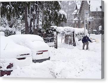 Man Clearing Snow, Braemar, Scotland Canvas Print by Duncan Shaw