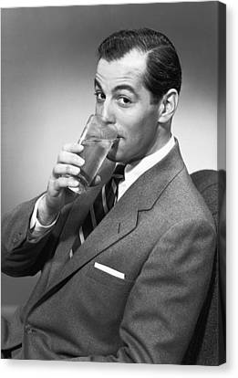 Man Drinking Water From Glass, Posing In Studio, (b&w), Portrait Canvas Print by George Marks