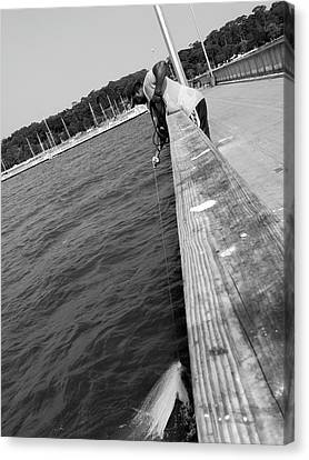 Man Fishing With Net Canvas Print by Floyd Smith