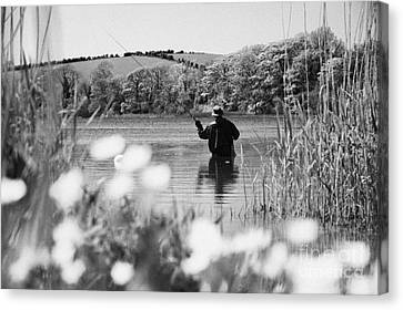 Man Flyfishing On Lake In Ireland Canvas Print by Joe Fox