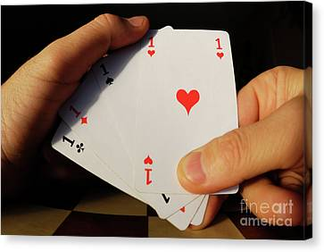 Man Holding Four Aces Cards In Hand Canvas Print by Sami Sarkis