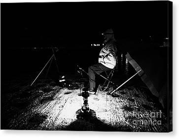 Man Nighttime Fishing Canvas Print by Joe Fox