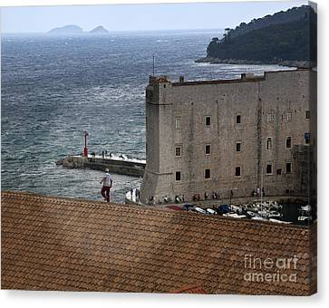 Man On The Roof In Dubrovnik Canvas Print by Madeline Ellis
