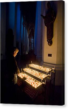 Man Prays By Candles At Frauenkirche Canvas Print by Greg Dale