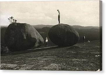 Man Stands Atop A Huge Boulder On Bald Canvas Print by Herbert E. Gregory