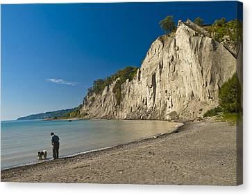 Man Walking His Dog Along Scarborough Canvas Print