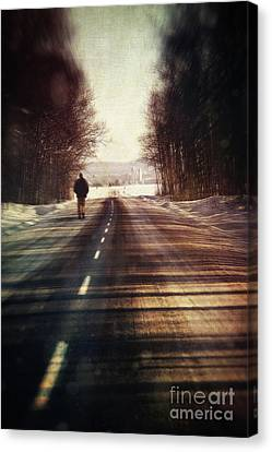 Man Walking On A Rural Winter Road Canvas Print
