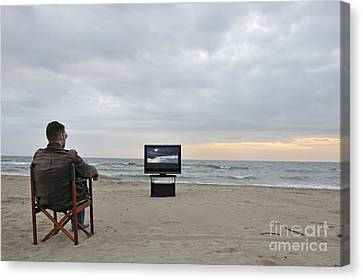 Man Watching Tv On Beach At Sunset Canvas Print by Sami Sarkis