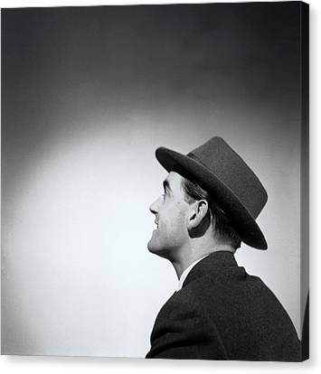 Man Wearing Hat Looking In Distance (b&w) Canvas Print by Hulton Archive