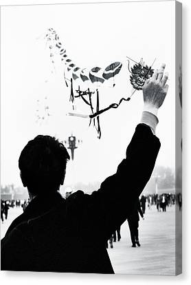 Man With A Kite Canvas Print