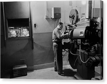Man Working A Projector In A Movie Canvas Print by Everett