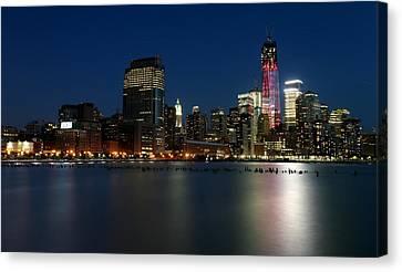 Manhattan Skyline At Night Canvas Print by Larry Marshall