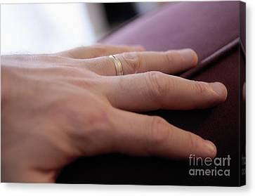 Man's Hand On Sofa With Wedding Ring Canvas Print by Sami Sarkis