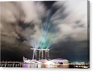 Marina Bay Colourful Night Canvas Print by Paul Biris