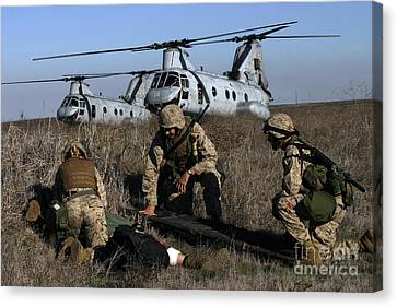 Marines And Sailors Being Transported Canvas Print by Stocktrek Images