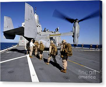 Marines Board An Mv-22 Osprey Aboard Canvas Print by Stocktrek Images